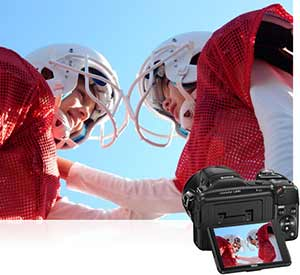 Nikon COOLPIX L830 shot of two boys in football gear inset with the camera's LCD showing the image.