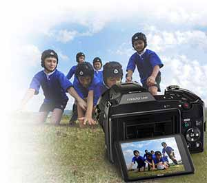 Photo of the COOLPIX L840 on the ground capturing kids playing rugby