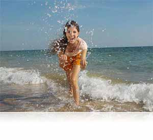 Nikon COOLPIX S33 photo of a girl splashing in the surf showing waterproof feature