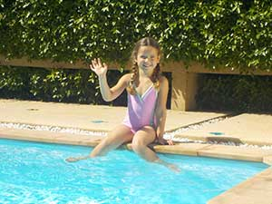Nikon COOLPIX S33 photo of a girl poolside, showing the zoom range