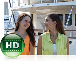Nikon COOLPIX S3600 photo of two women with the HD video icon showing HD capabilities.