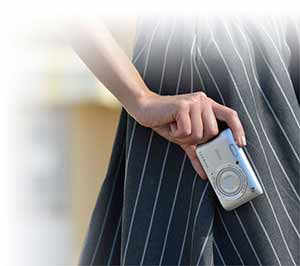 Photo of a person holding the Nikon COOLPIX S3700