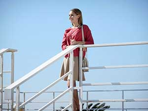 Nikon COOLPIX S3700 photo of a woman leaning on a railing showing the camera's zoom range