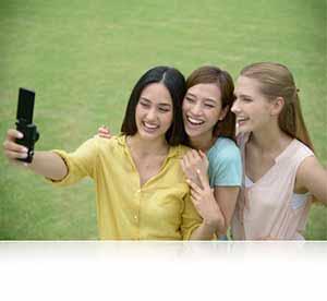Nikon COOLPIX S6900 photo of three women taking a selfie photo.