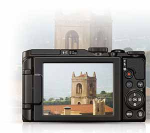 Photo of the reaar of the COOLPIX S7000 with a castle on the LCD and in the background