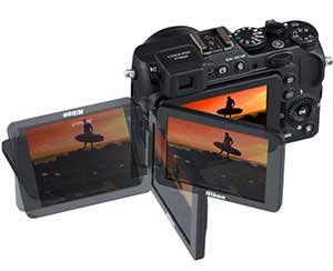 Composite photo of the COOLPIX P7800 and the surfer photo showing the Vari-angle LCD