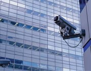 One security camera on the side of a building