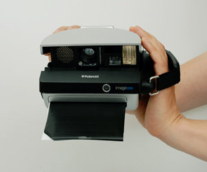 Spectra camera with frog tongue