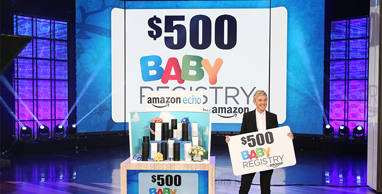 Ellen holding $500 gift card from Baby Registry by Amazon