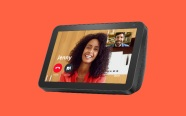 Echo Show 8 on orange background. On sale for $64.99 was $129.99.