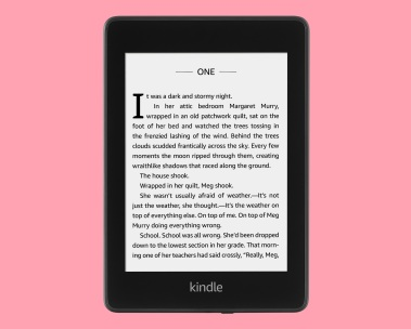 Kindle Paperwhite atop a pink background