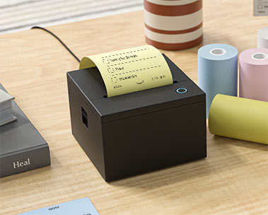 Picture of the Smart Sticky Note Printer on a desk.