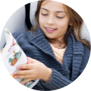 A child reading a graphic novel
