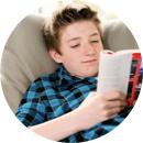 A teenager reading a novel