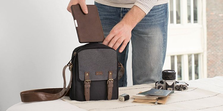 Image of man packing Kindle for travel