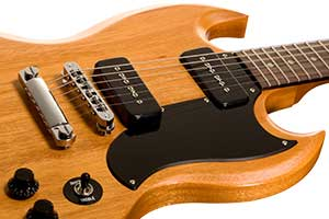 A solid mahogany body with beveled edges