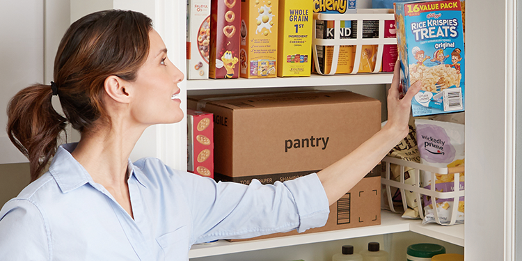 Woman putting groceries into pantry