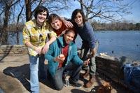 friends posing by the riverside