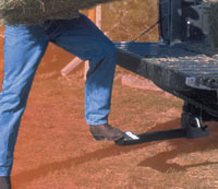Loading hay using the Heininger HitchMate TruckStep
