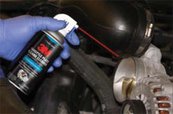 3M Throttle Plate and Carb Cleaner being sprayed on a throttle plate