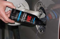 3M Complete Fuel System Cleaner being added to the contents of a gas tank