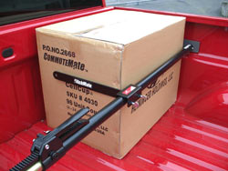 The Heininger HitchMate Cargo Stabilizer Bar used with the optional StabiLoad Divider Bar accessory