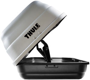 A Thule 682 Sidekick Rooftop Cargo Box opened from the passenger side