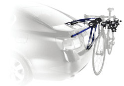 The Thule Speedway 2-Bike Trunk Rack Carrier mounted on a car rack