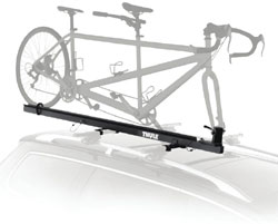 The Thule Tandem Bicycle Pivoting Roof Mount Carrier mounted on a car rack
