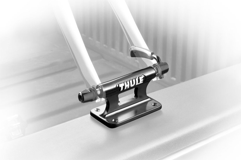 The Thule 821 Low Rider Bicycle Fork Mount mounted on a truck bed side