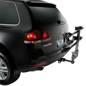 The Thule 990XT Doubletrack Platform Hitch Bike Rack folded up while still attached to a car, but not in use