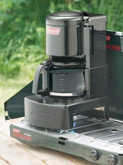 stove coffee maker. the coleman camping coffeemaker sits atop a 2- or 3-burner stove. stove coffee maker