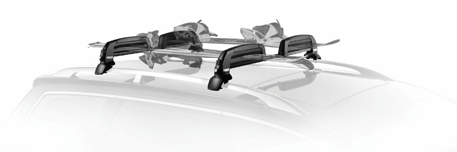 The Thule 5401 Snowcat Ski And Snowboard Carrier Loaded And Installed On A  Vehicle