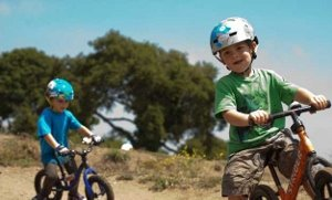Boy riding bike with Bell Fraction Helmet