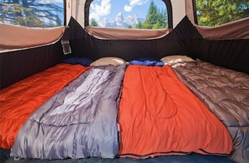 A roomy interior offers enough space for two queen-sized air mattresses. & Camping Tent Coleman 6 Person Instant Cabin In 60 Seconds Water ...