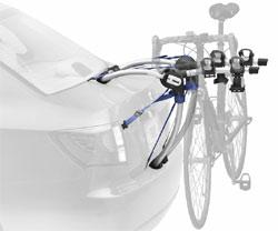 The Thule 9007 Gateway 3-Bike Trunk/Strap Mount Rack mounted on a car trunk