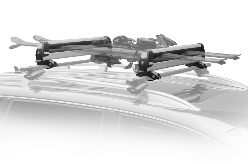 An Installed Thule 92726 Universal Pull Top 6 Pair Ski And Snowboard  Carrier Loaded With Skis