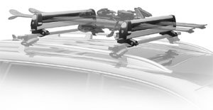 An installed Thule 92725 universal flat top 6 pair ski and snowboard carrier loaded with skis