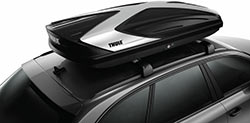 The Thule 612 Hyper Roof Box seen from the side mounted on a roof rack