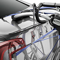 A Thule 9009XT Archway 2-Bike Carrier strapped to a trunk