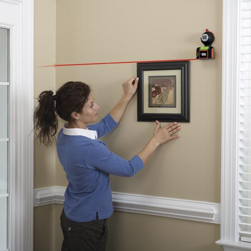 how to use a laser level to hang pictures
