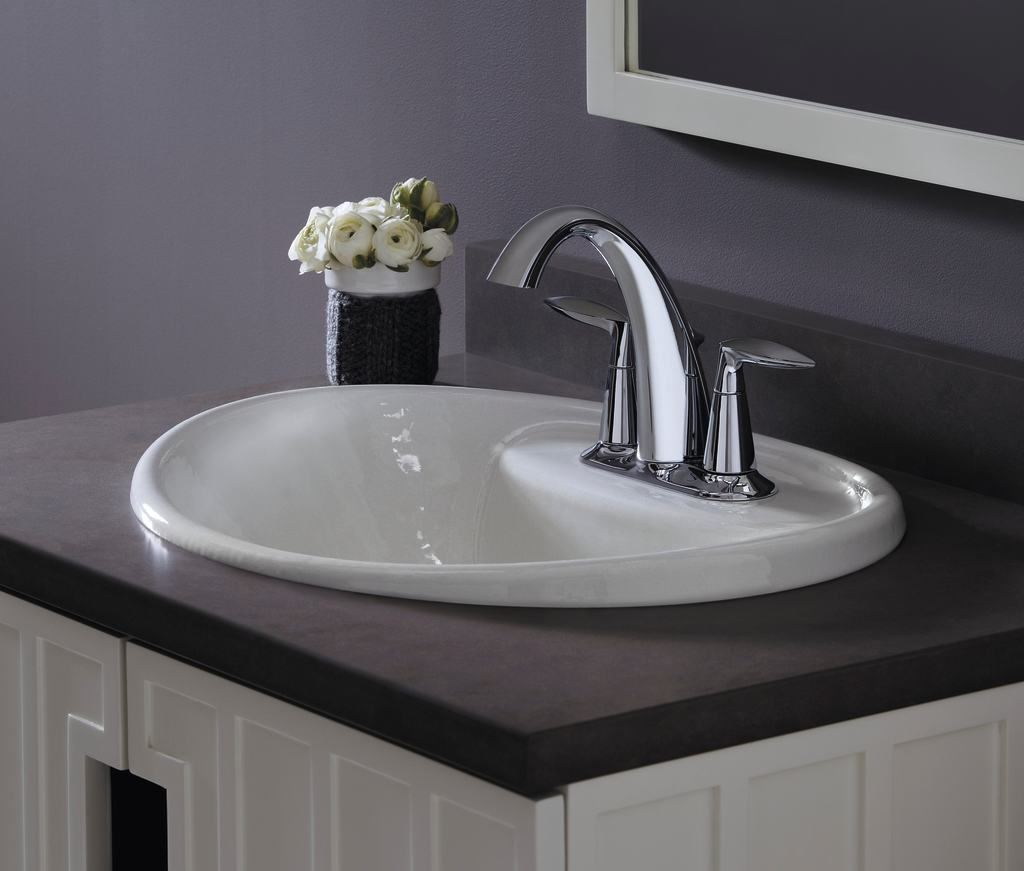 vibrant brushed nickel touch on bathroom sink faucets