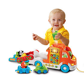 Take the Pull and Learn Car Carrier for a spin and watch baby