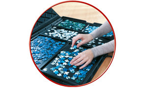 Puzzle stoarge case with sorting trays to keep puzzle pieces organized.