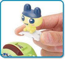 Slide Gotchi Figures onto your Tama-Go