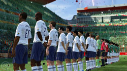 Two teams lined up, facing the crowd before a game in 2010 FIFA World Cup