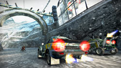 Various vehicles in a lower elevation race in 'MotorStorm: Arctic Edge'