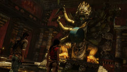 Drake and Chloe checking out a temple statue in 'Uncharted 2: Among Thieves'
