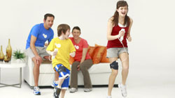Two kids using the Nunchuck leg strap to do cardio exercises in 'EA SPORTS Active'