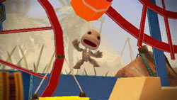 Sackboy catching some air in LittleBigPlanet for PSP